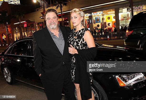 Actor John Goodman and his daughter Molly Goodman arrive for the AFI Fest 2011 Special Screening of The Artist presented by Audi at Grauman's Chinese...