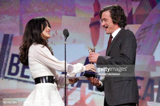 Actor John Hawkes accepts award from actress Salma Hayek onstage during the 2013 Film Independent Spirit Awards at Santa Monica Beach on February 23...