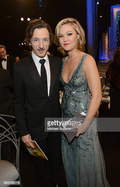 Actor John Hawkes and actress Julia Stiles attend the 19th Annual Screen Actors Guild Awards at The Shrine Auditorium on January 27 2013 in Los...