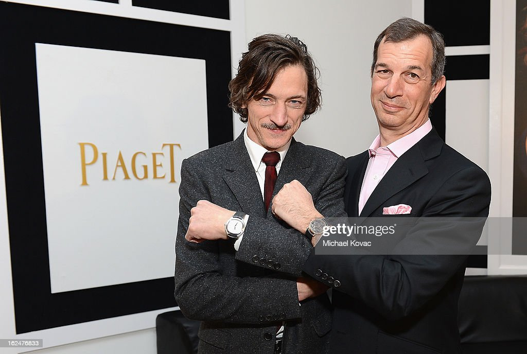 Actor John Hawkes and CEO of Piaget Philippe Leopold-Metzger pose in the Piaget poses in the Piaget Lounge during The 2013 Film Independent Spirit Awards on February 23, 2013 in Santa Monica, California.