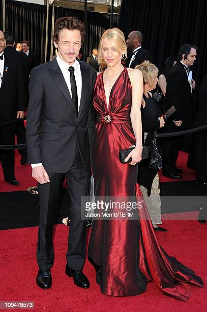 Actor John Hawkes and guest arrive at the 83rd Annual Academy Awards held at the Kodak Theatre on February 27 2011 in Hollywood California