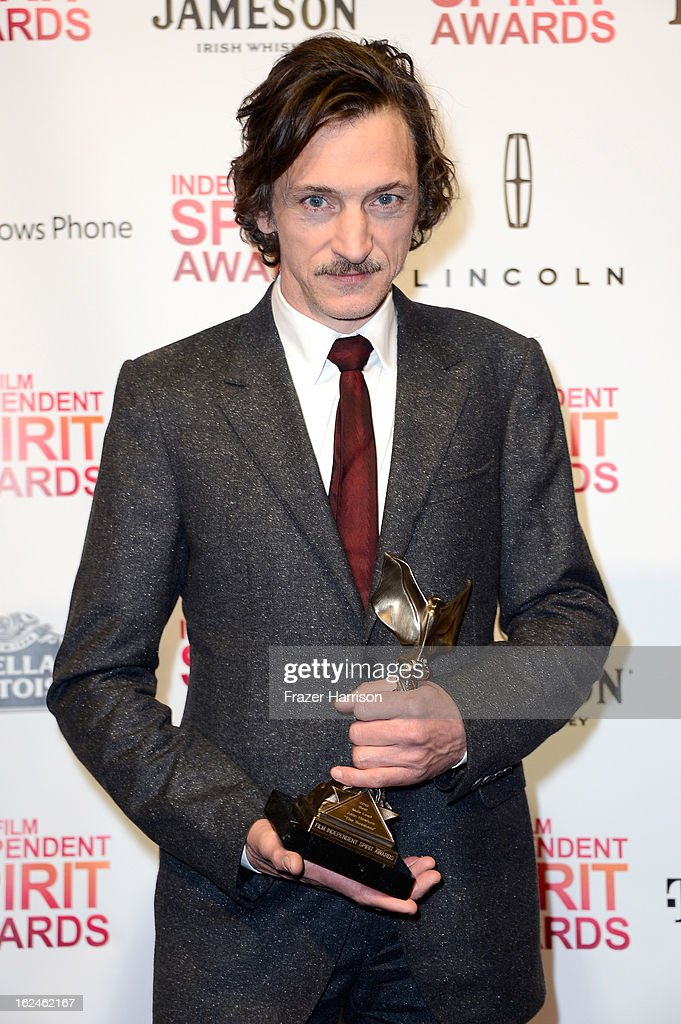Actor John Hawkes poses with the Best Male Lead award for 'The Sessions' in the press room during the 2013 Film Independent Spirit Awards at Santa Monica Beach on February 23, 2013 in Santa Monica, California.