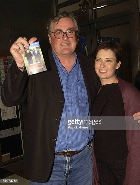 Actor John Howard and his wife Kim Lewis attend the premiere of Michael Moore's Fahrenheit 9/11 at Fox Studios July 15 2004 in Sydney Australia