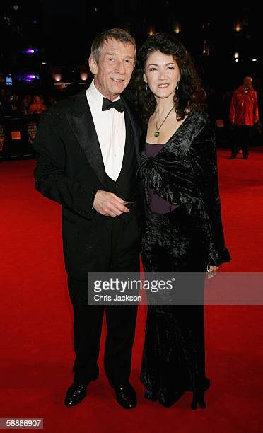 Actor John Hurt and Ann Rees Meyers arrive at The Orange British Academy Film Awards at the Odeon Leicester Square on February 19 2006 in London...