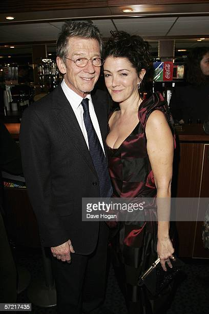 Actor John Hurt and his wife Anwen ReesMyers arrive at the UK Premiere of 'Shooting Dogs' at the Curzon Mayfair on March 30 2006 in London England...