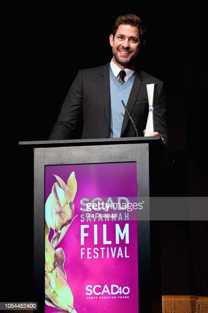 "Actor John Krasinski accepts an award onstage during the ""A Quiet Place"" award presentation and screening at the 21st SCAD Savannah Film Festival on..."