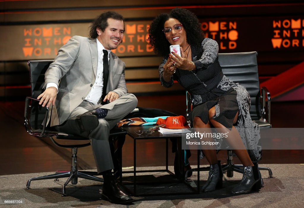 Actor John Leguizamo (L) and Sarah Jones speak on stage at the 8th Annual Women In The World Summit at Lincoln Center for the Performing Arts on April 7, 2017 in New York City.