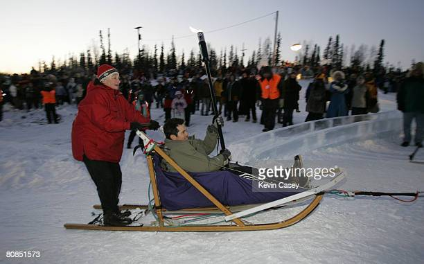 Actor John Leguizamo signs rides sled dogs into the welcoming event for the opening of ICE AGE THE MELTDOWN Park in Fairbanks Alaska on March 12 2006...