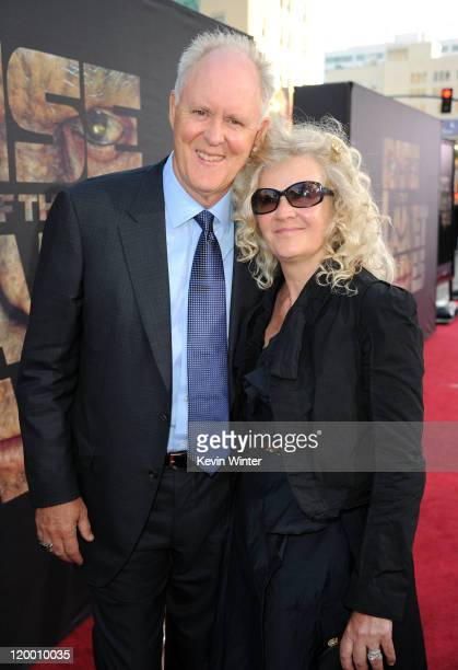 Actor John Lithgow and Mary Yeager arrive at the premiere of 20th Century Fox's Rise Of The Planet Of The Apes held at Grauman's Chinese Theatre on...