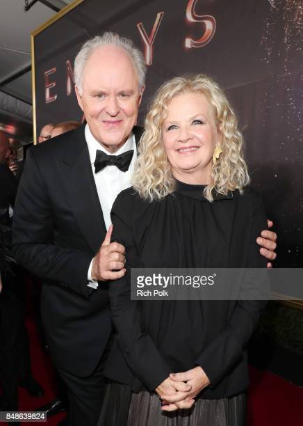 Actor John Lithgow and Mary Yeager walk the red carpet during the 69th Annual Primetime Emmy Awards at Microsoft Theater on September 17 2017 in Los...