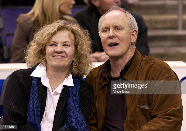 Actor John Lithgow and wife Mary Yeager attend the game between the Los Angeles Lakers and the New Jersey Nets on January 24 2003 at the Staples...