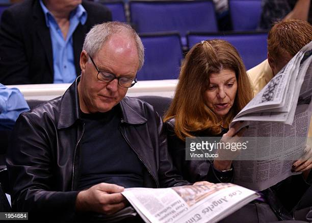 Actor John lithgow and wife Mary Yeager wait for the start of the Lakers v Timberwolves in game 4 of the first round of the 2003 NBA playoffs at the...