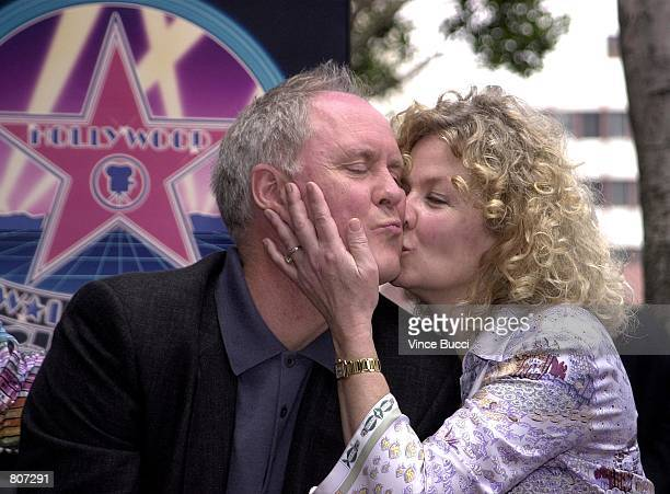 Actor John Lithgow gets a kiss from his wife Mary Yeager at the ceremony honoring him with the 2176th star on the Hollywood Walk of Fame May 2 2001...