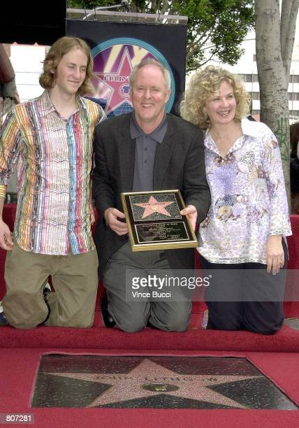 Actor John Lithgow poses with his son Nate left and his wife Mary Yeager at the ceremony honoring him with the 2176th star on the Hollywood Walk of...