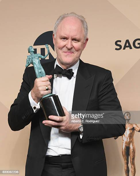 Actor John Lithgow winner of the Outstanding Performance by a Male Actor in a Drama Series award for 'The Crown' poses in the press room during the...
