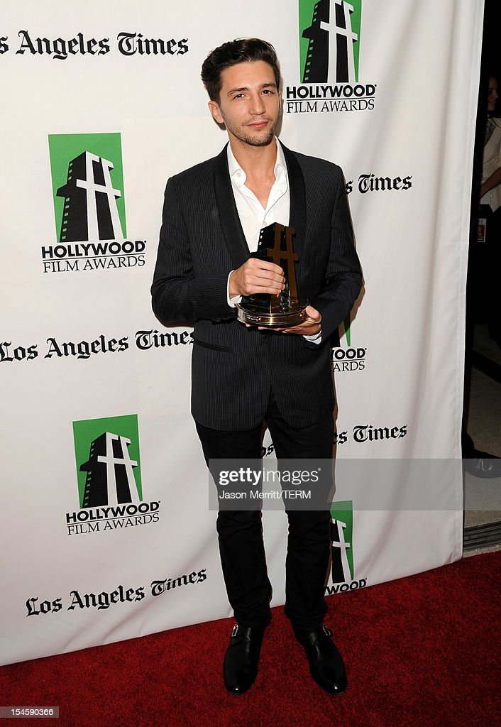 Actor John Magaro poses with the Hollywood Spotlight Award during the 16th Annual Hollywood Film Awards Gala presented by The Los Angeles Times held at The Beverly Hilton Hotel on October 22, 2012 in Beverly Hills, California.