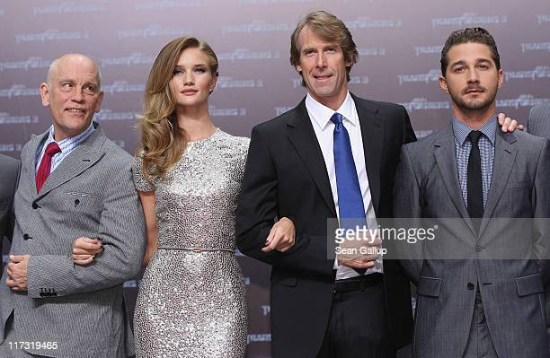 Actor John Malkovich actress Rosie HuntingtonWhiteley director Michael Bay and actor Shia LaBeouf attend the 'Transformers 3' press conference at the...