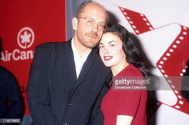 Actor John Malkovich actress Sherilyn Fenn pose for a portrait in 1992 in Los Angeles California