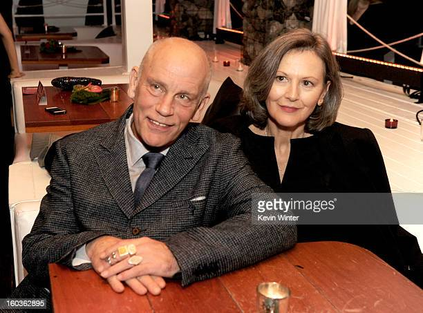 Actor John Malkovich and his wife Nicoletta Peyran pose at the after party for the premiere of Summit Entertainment's Warm Bodies at The Colony on...