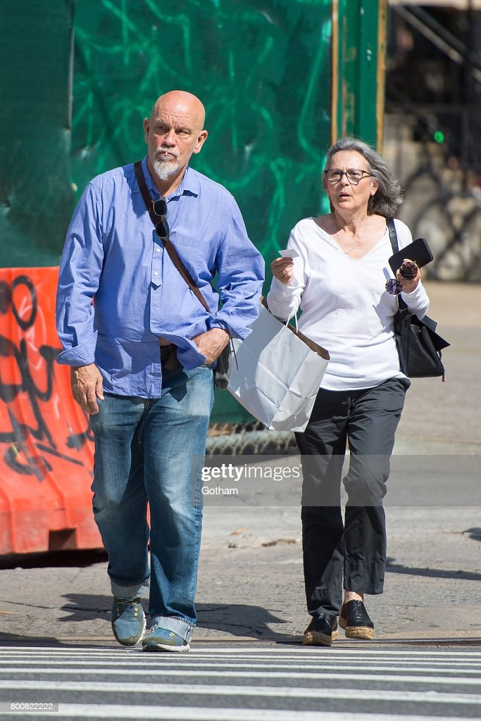 John Malkovich with gracious, Girlfriend Nicoletta Peyran