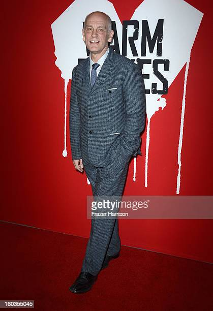 Actor John Malkovich arrives at the premiere of Summit Entertainment's Warm Bodies at ArcLight Cinemas Cinerama Dome on January 29 2013 in Hollywood...