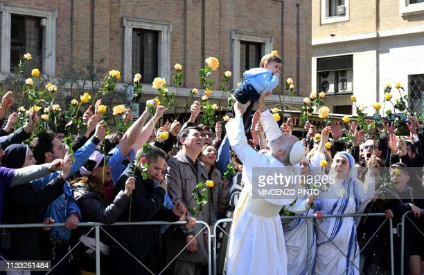 TOPSHOT US actor John Malkovich dressed as pope lifts a baby during the filming of The new Pope the sequel of Paolo Sorrentino's movie The young Pope...