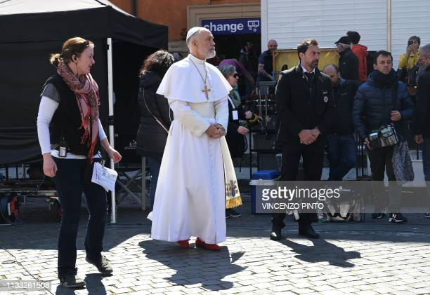 US actor John Malkovich dressed as pope stands during a break of the filming of The new Pope the sequel of Paolo Sorrentino's movie The young Pope in...