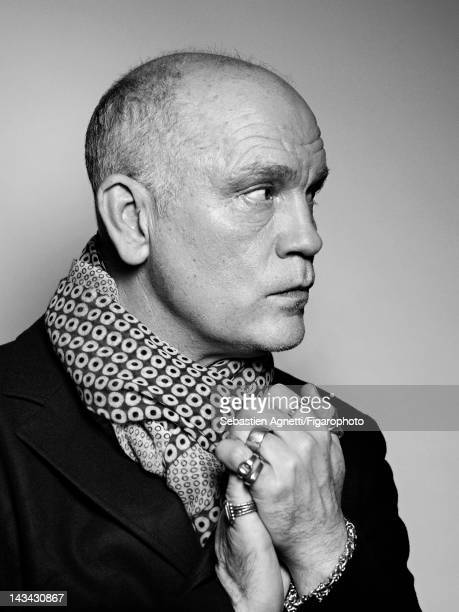 Actor John Malkovich poses for Madame Figaro on December 10 2011 in Paris France PUBLISHED IMAGE Figaro ID 102732002 Jacket and scarf by...
