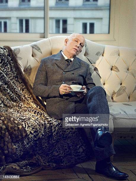 Actor John Malkovich poses for Madame Figaro on December 10 2011 in Paris France PUBLISHED IMAGE Figaro ID 102732004 Suit tie and shirt by...
