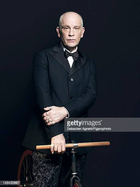 Actor John Malkovich poses for Madame Figaro on December 10 2011 in Paris France Figaro ID 102732008 Jacket and pants by Technobohemian by John...