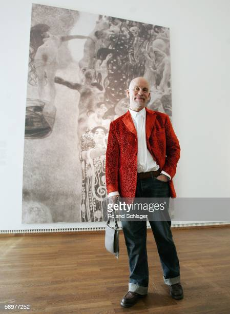Actor John Malkovich poses in front of Gustav Klimt's painting 'Medizin' during a press conference for the film 'Klimt' at the LeopoldMuseum on March...