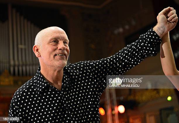 """Actor John Malkovich recieves applause on the stage of the Romanian Athenaeum after he played the last performance of """"The Infernal Comedy -..."""