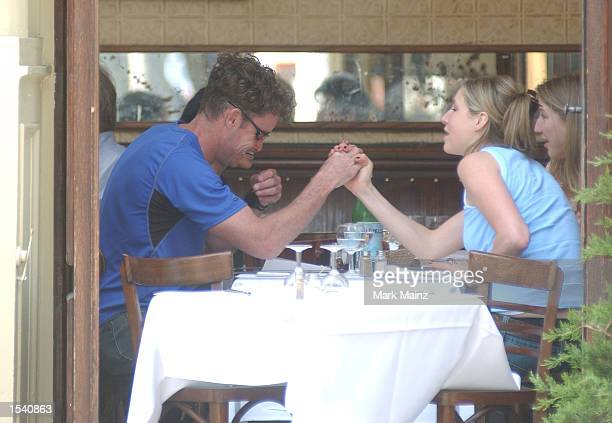 Actor John McGinley arm wrestles with a friend during lunch May 8 2002 in New York City