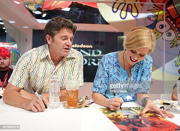 Actor John Michael Higgins and actress Janet Varney sign autographs at the Legend of Korra signing at the 2014 San Diego ComicCon International Day 3...