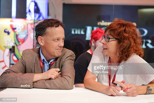 Actor John Michael Higgins and actress Mindy Sterling sign autographs at the Legend of Korra signing at the 2014 San Diego ComicCon International Day...
