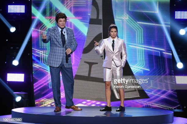 Actor John Michael Higgins and host Danica Patrick speak onstage at The 2018 ESPYS at Microsoft Theater on July 18 2018 in Los Angeles California