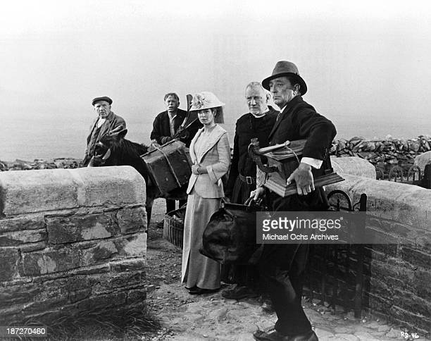 Actor John Mills actress Sarah Miles actors Trevor Howard and Robert Mitchum on set of the MetroGoldwynMayer movie Ryan's Daughter in 1970