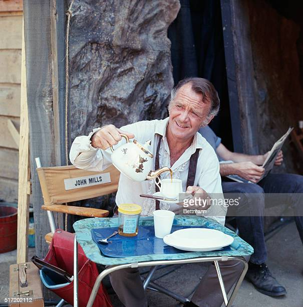 Actor John Mills star of the short lived TV series Dundee and the Culhane on the set of the show having coffee