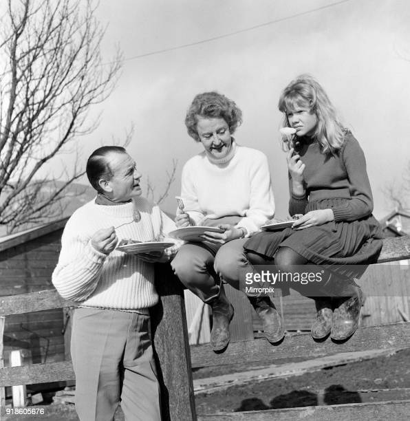 Actor John Mills, wife Mary Hayley Bell and their daughter Hayley Mills pictured out in the sun at Downham, Lancashire, studying the script of the...