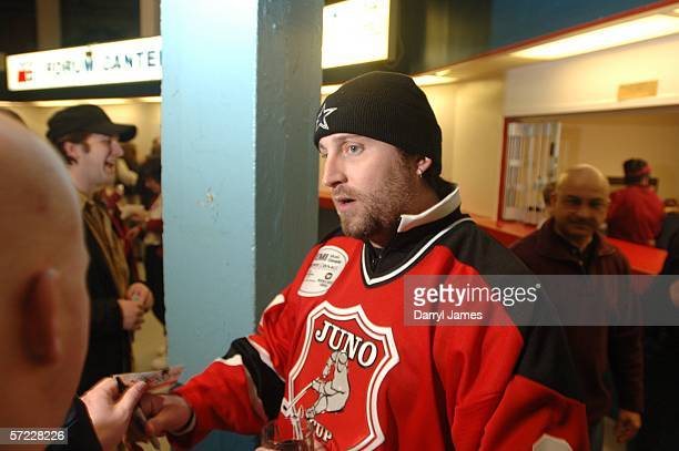 Actor John Paul Tremblay signs autographs for fans at the Juno Cup Game on March 31, 2006 in Halifax, Nova Scotia, Canada. The Juno Cup is an annual...