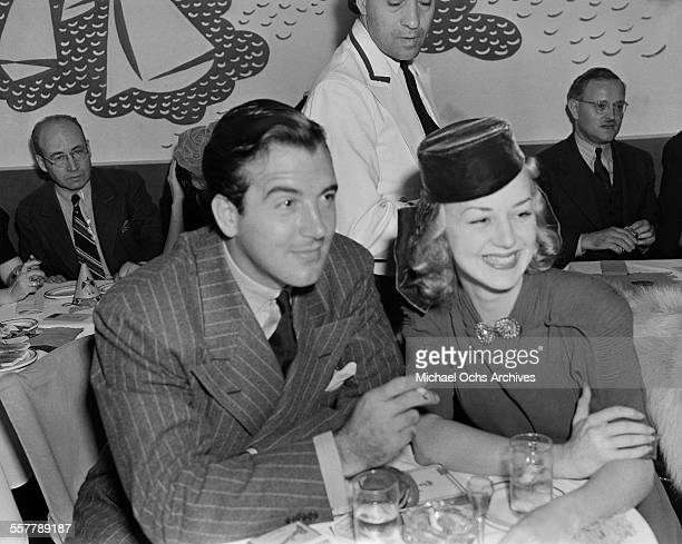 Actor John Payne and his wife actress Anne Shirley pose as they have lunch in Los Angeles California