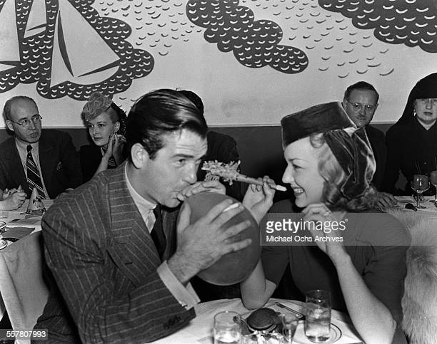Actor John Payne and wife actress Anne Shirley have fun during an event in Los Angeles California