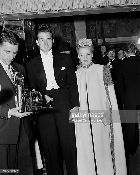Actor John Payne with wife actress Anne Shirley arrive at an event in Los Angeles California
