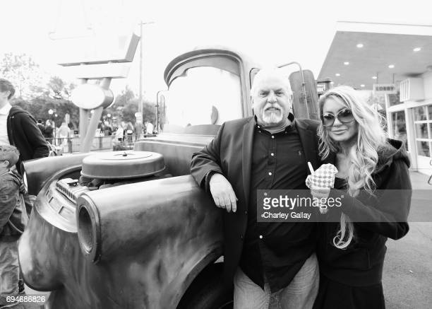 """Actor John Ratzenberger and Julie Blichfeldt at the after party for the World Premiere of Disney/Pixar's """"Cars 3"""" at Cars Land at Disney California..."""