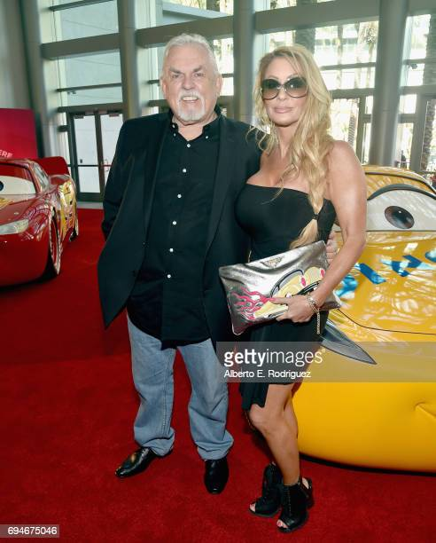 """Actor John Ratzenberger and Julie Blichfeldt at the World Premiere of Disney/Pixar's """"Cars 3 at the Anaheim Convention Center on June 10 2017 in..."""