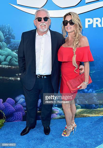 Actor John Ratzenberger and Julie Blichfeldt attend The World Premiere of DisneyPixar's FINDING DORY on Wednesday June 8 2016 in Hollywood California