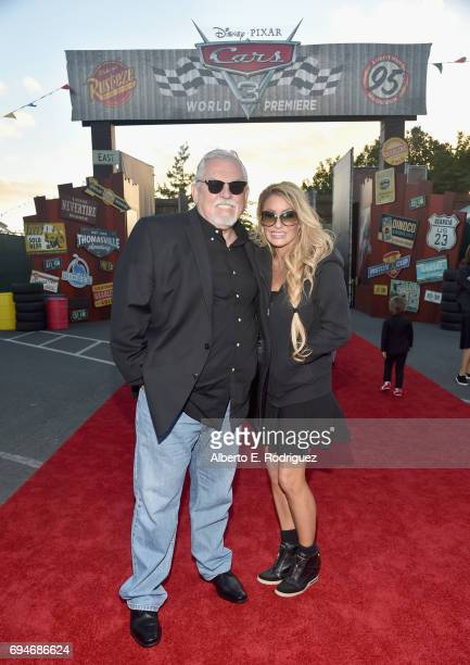"""Actor John Ratzenberger and Julie Blichfeldt pose at the after party for the World Premiere of Disney/Pixar's """"Cars 3"""" at Cars Land at Disney..."""
