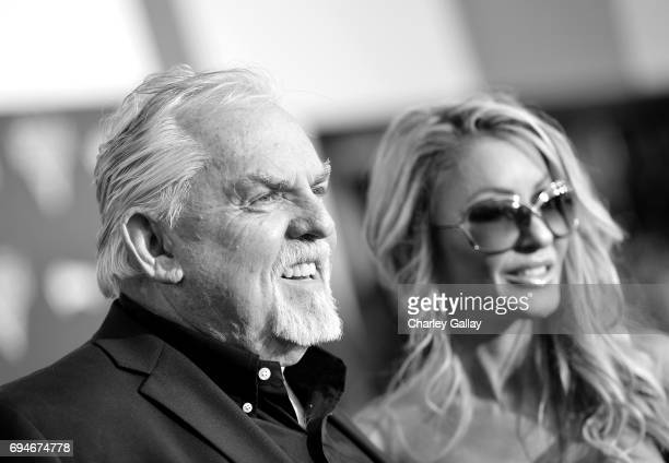 """Actor John Ratzenberger and Julie Blichfeldt pose at the World Premiere of Disney/Pixar's """"Cars 3 at the Anaheim Convention Center on June 10 2017 in..."""