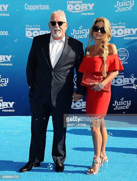 Actor John Ratzenberger and wife Julie Blichfeldt attend the premiere of Finding Dory at the El Capitan Theatre on June 8 2016 in Hollywood California