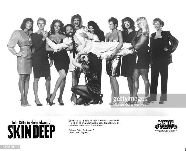Actor John Ritter poses with women for the movie Skin Deep circa 1989